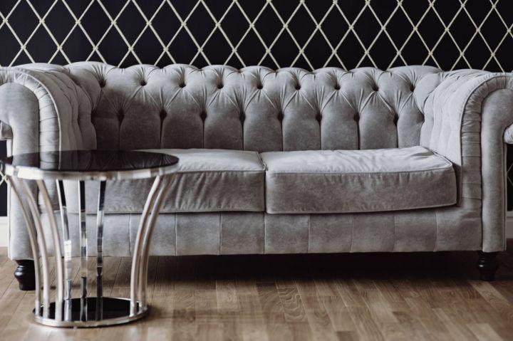 kaboompics_Elegant grey sofa and a table