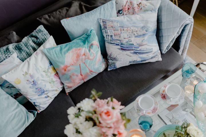 kaboompics_Blue pillows on a comfy sofa